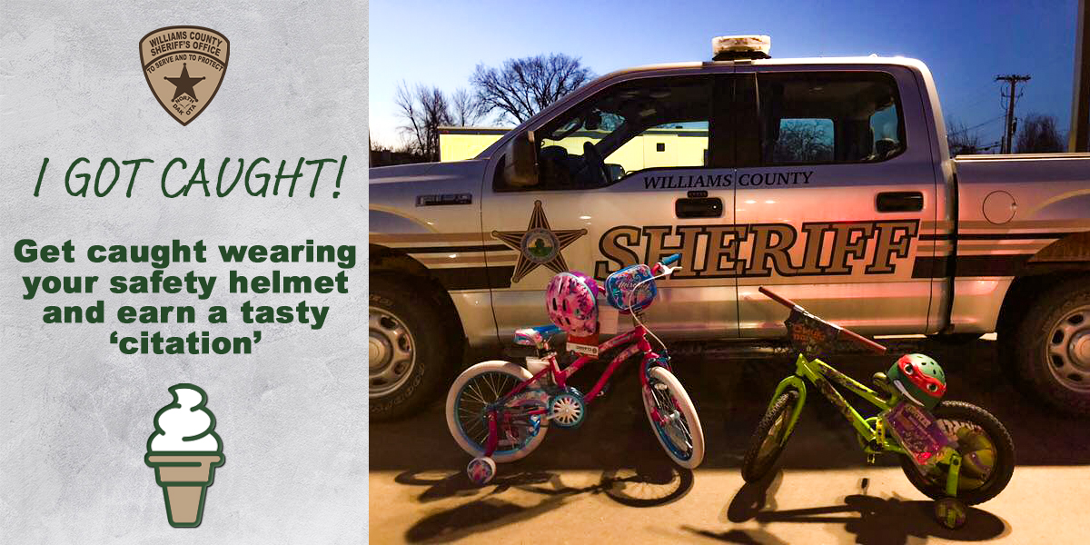 Sheriff's badge and ice cream cone pictured with a Sheriff's pickup truck and children's bicycles and helmets