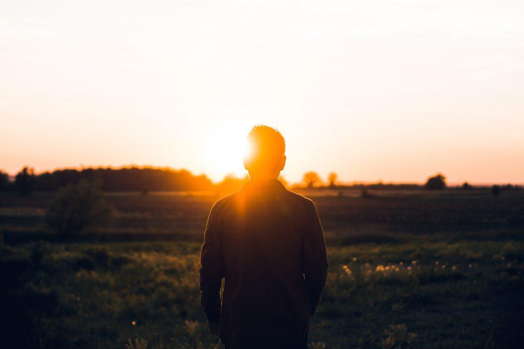 Young man facing sun 1024x683