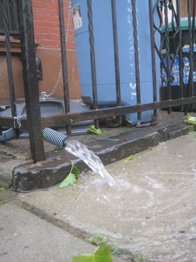 2011_28_August_Hurricane_Irene_Gowanus_Canal_the_basement_flood_pumps__were_working_hard_on_Sackett_Street_pic_by_Eymund.jpg