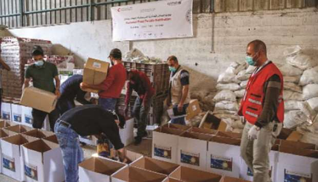 QRCS, Qatar Airways distribute food baskets in Jordan and Gaza