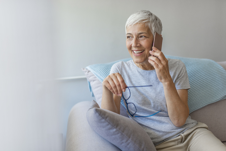 a senior woman talking on the phone