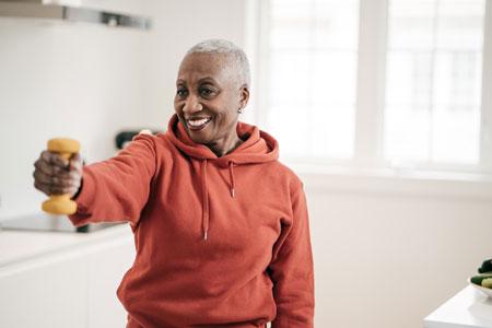 senior woman lifts a light weight