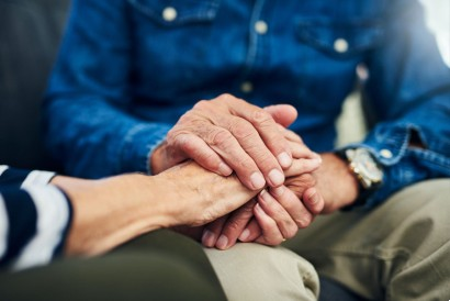 senior holding his senior wife's hands in his