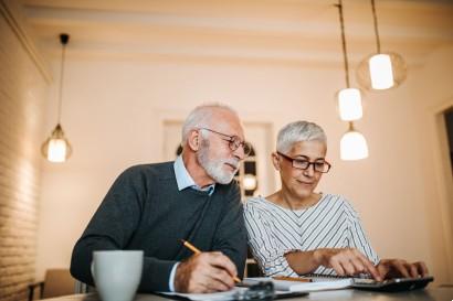 senior couple working on their senior living finances