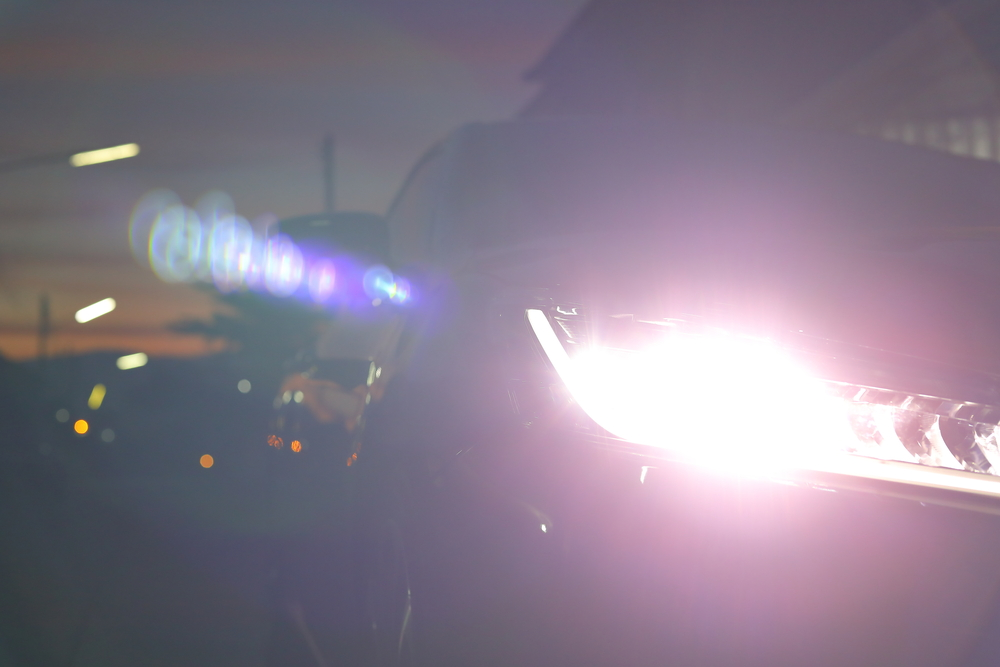 Car headlights with a high beam could cause trouble to opposing traffic.