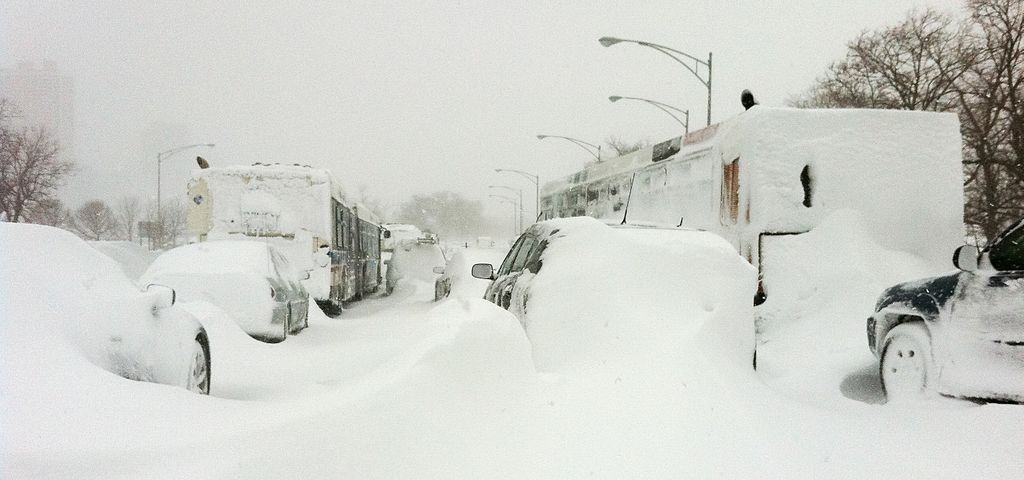 Cars and trucks stuck in snow