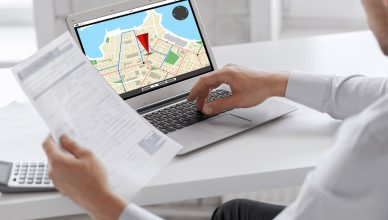 Businessman tracking vehicles on a laptop