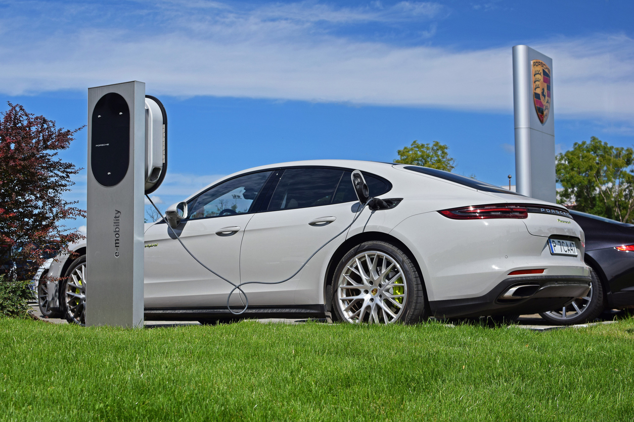White Porsche Panamera E Hybrid an electric vehicle at charging station