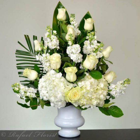 All white floral urn design of white roses hydrangeas and fragrant memorial white flowers funerals roses hydrangeas stocks san rafael mightylinksfo