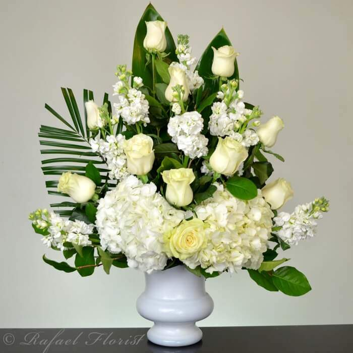 All white floral urn design of white roses hydrangeas and fragrant memorial white flowers funerals roses hydrangeas stocks san rafael home mightylinksfo