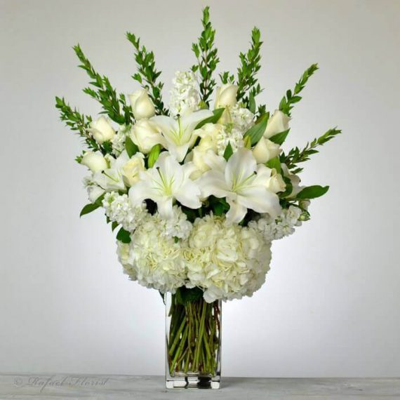Beautiful all white floral arrangement of lilies hydrangeas and roses all white flower arrangement lilies roses hydrangeas mightylinksfo