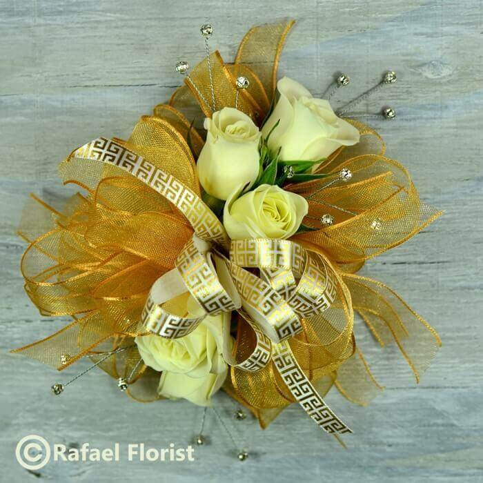 Prom Wrist Corsage Of White Roses And Gold Ribbons And Sparkling