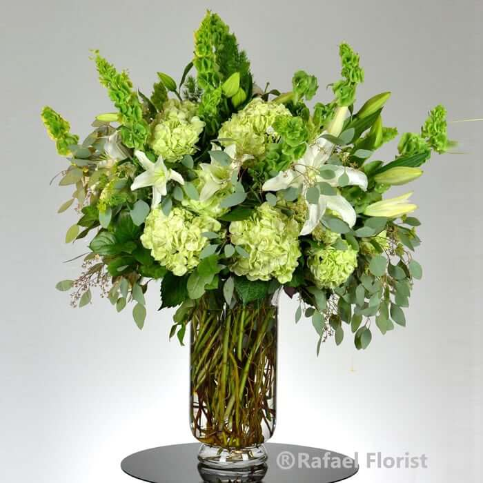 Green And White Flower Arrangement Of Lilies And Hydrangeas