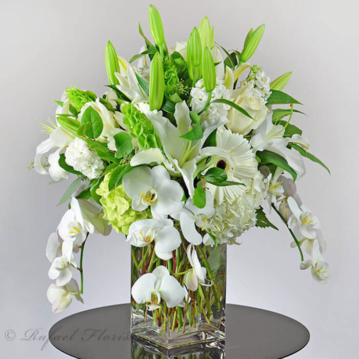 All White Flower Arrangement With Orchids Lilies And Hydrangeas
