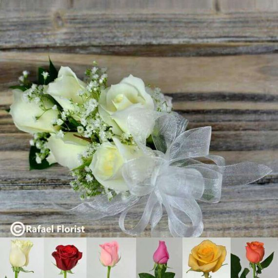 This classic prom wrist corsage of white baby roses and white ribbon white corsage for wrist with baby roses colors mightylinksfo