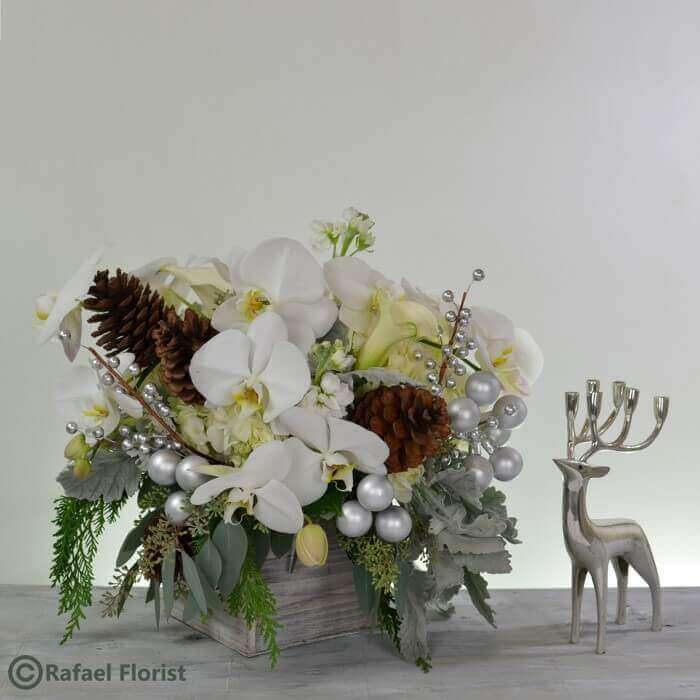 Christmas Flower Arrangements White.Silver And White Christmas Arrangement With Orchids And Hydrangeas