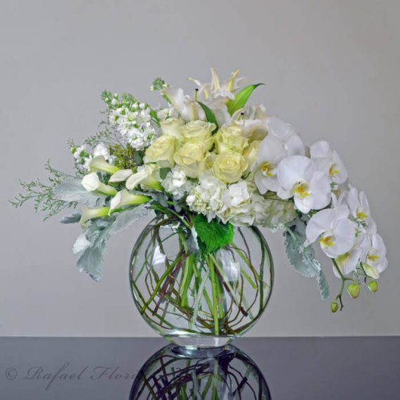 Contemporary flower design of white roses orchids hydrangeas roses all white flower arrangement of orchids hydrangeas roses calla lilies mightylinksfo
