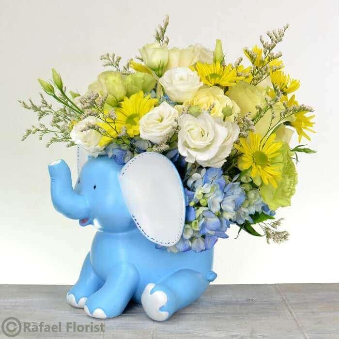 New baby boy flower arrangement in blue ceramic elephant container