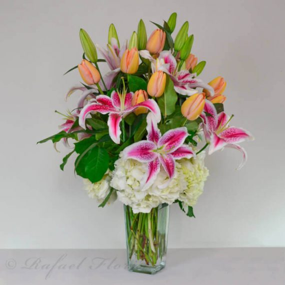 Pink stargazer lilies tulips white hydrangeas arranged in a french tulips stargazer lilies white hydrangeas mightylinksfo