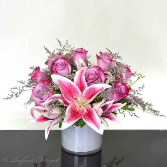 Lavender roses stargazer lilies designed in a beautiful cylinder vase lavender roses stargazer lilies floral arrangement in white cylinder vase mightylinksfo