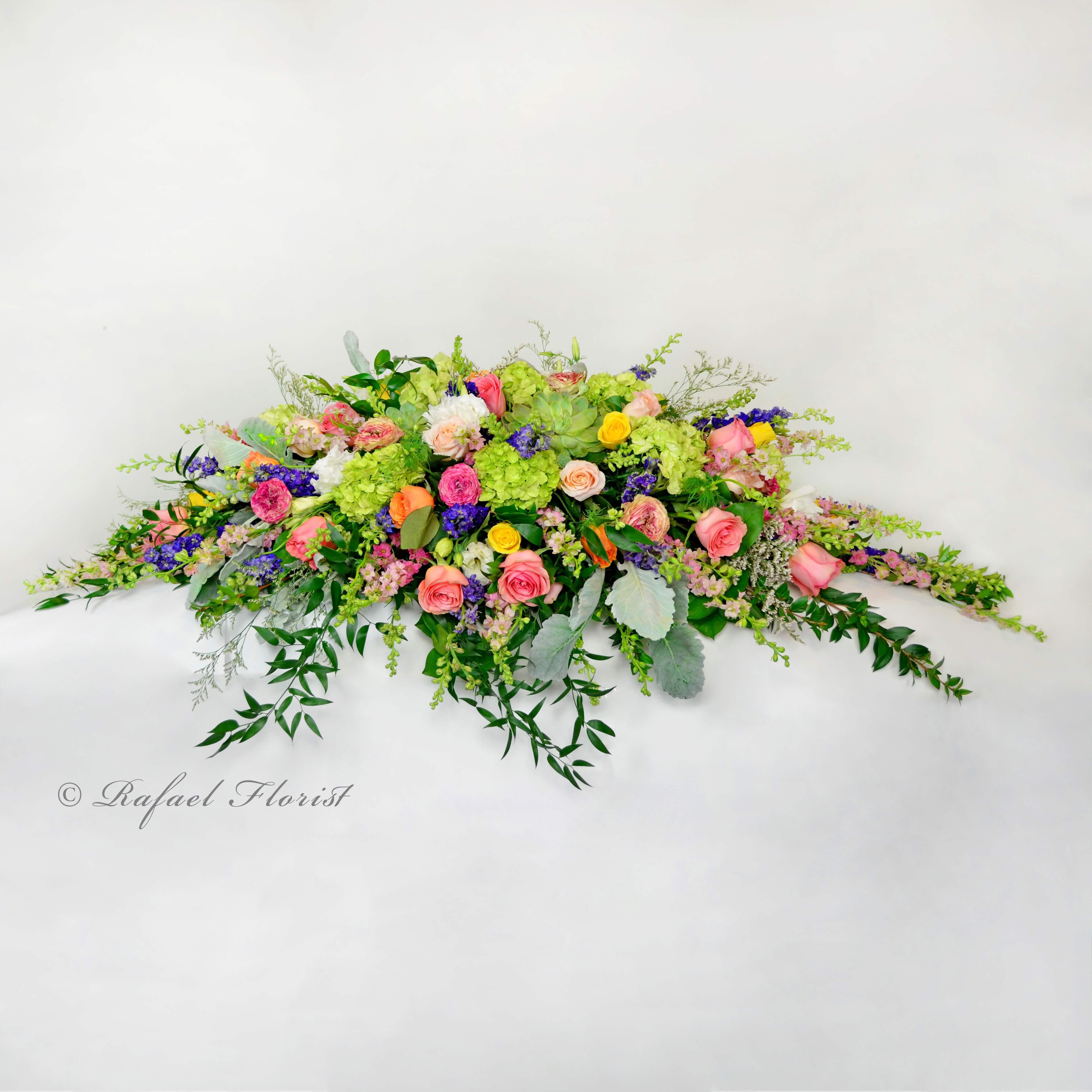 Pastel Casket Spray Of Roses Hydrangeas Succulents Larkspur