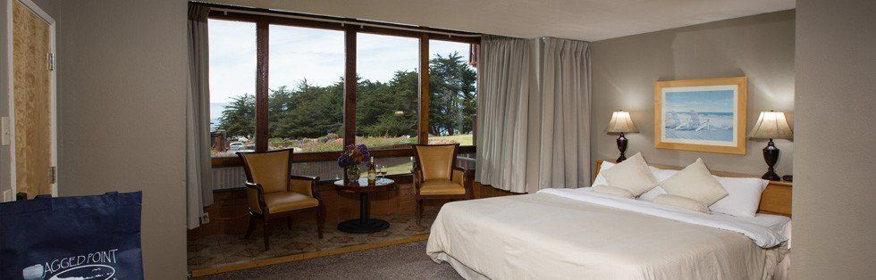 bed with windows overlooking grassy area