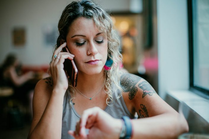 Woman using a telephone answering service