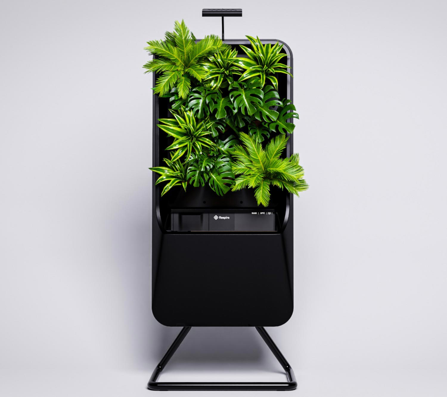 Black respira unit with tropical plant palette on stainless steel stand. light grey gradient background