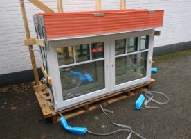 Holz-Fenster mit Rolläden