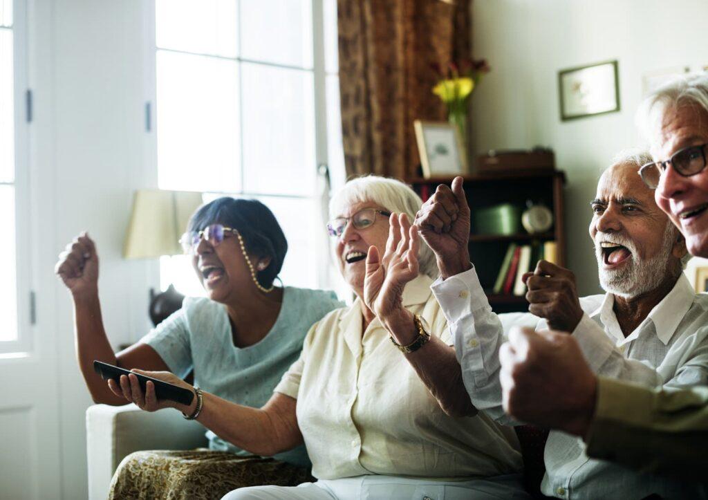 A group of elderly people watching tv | Rising Star Properties.