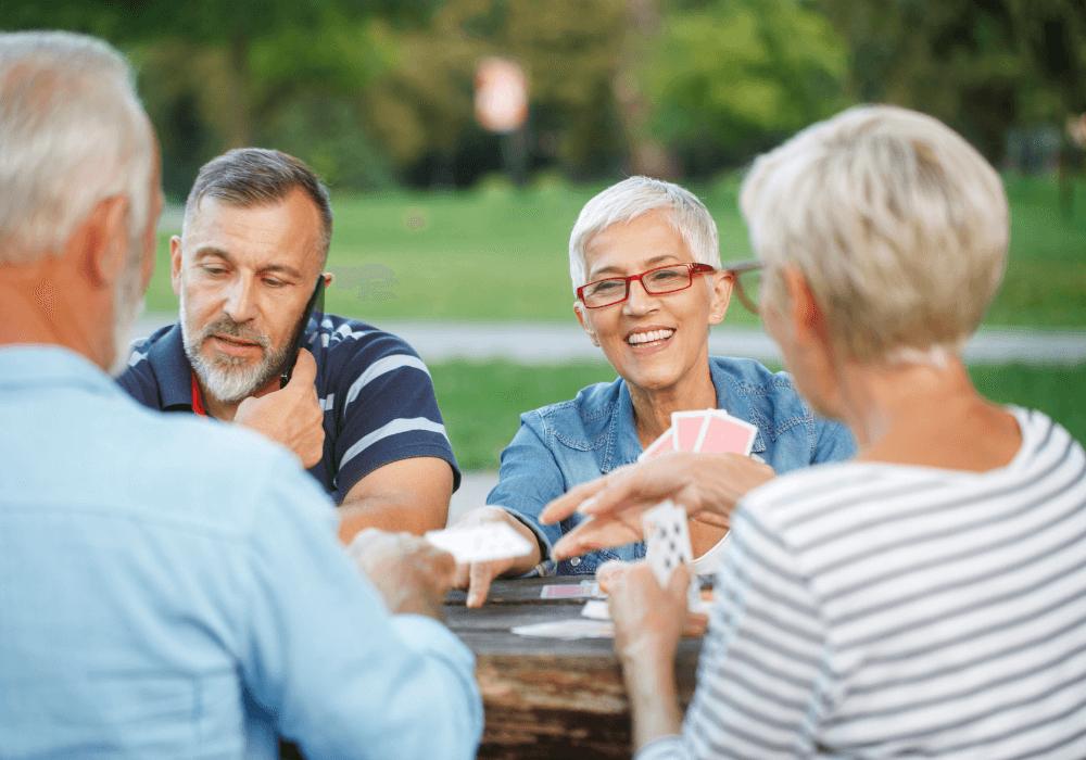 Seniors playing card games   Rising Star Properties