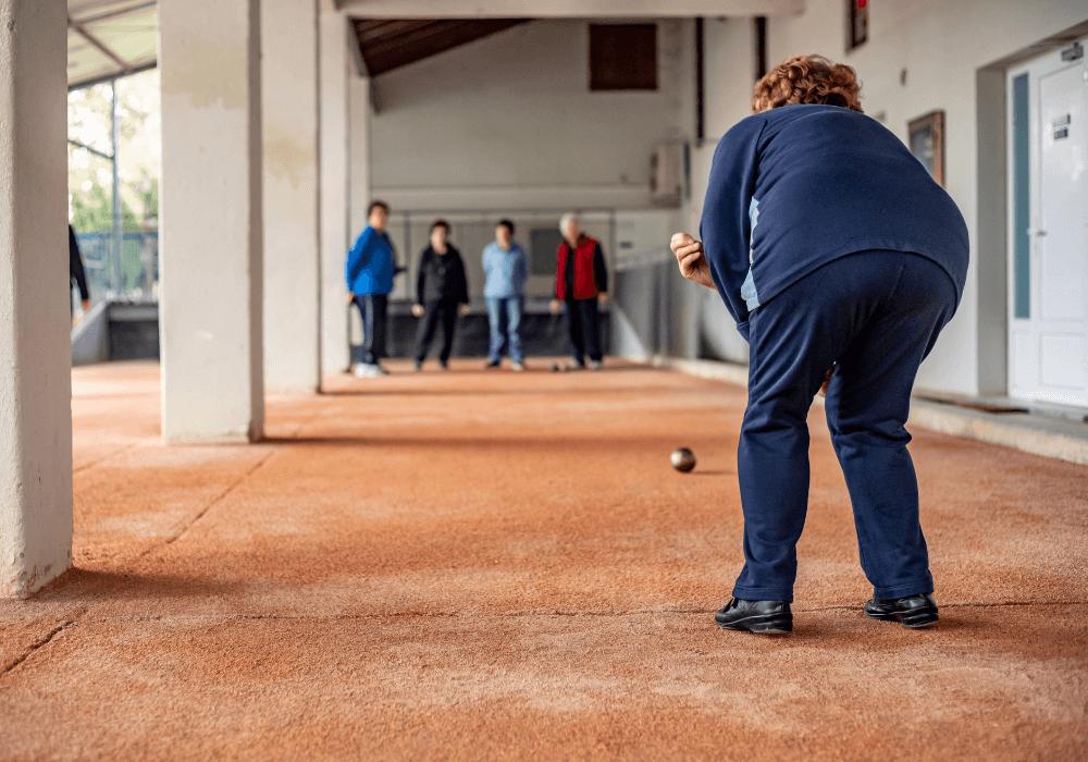Seniors playing indoor bocce   Rising Star Properties