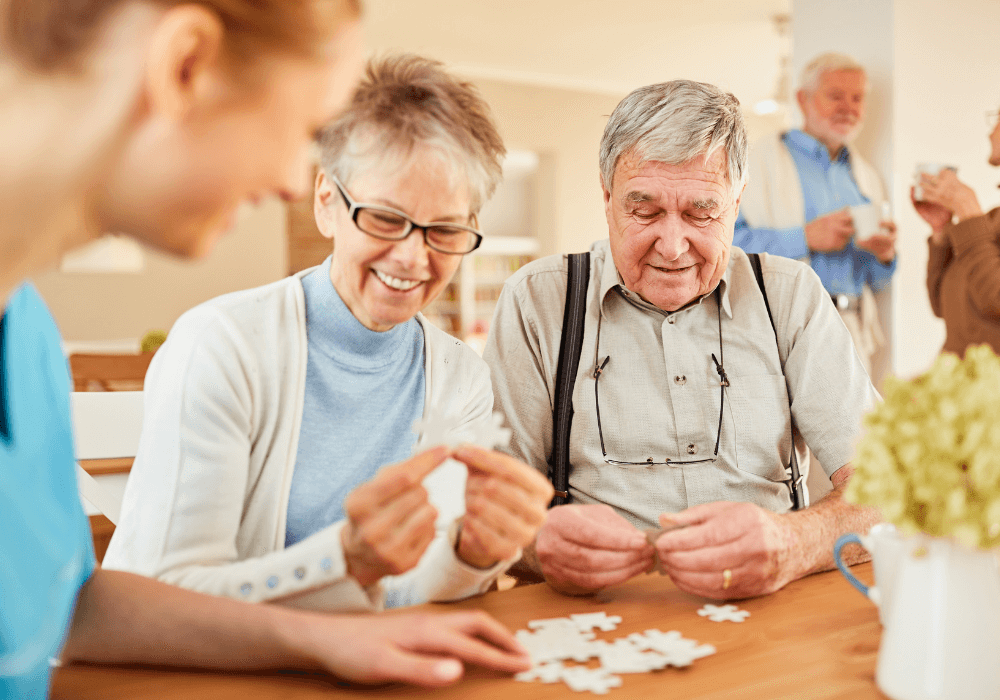 Seniors playing puzzles   Rising Star Properties