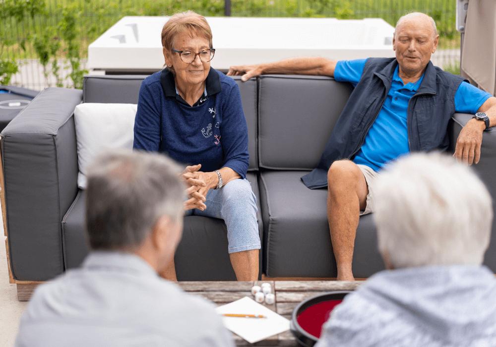Seniors talking at an outdoor space   RIsing Star Properties