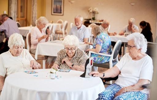 Seniors Playing Bingo At Their Living Space | Rising Star Properties