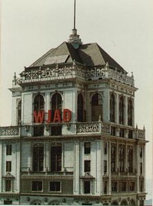 """Picture of Station Call Letters WJAD sign of steel and neon construction on a downtown building, in the Big Apple"""