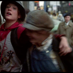 "Nicky and Pammy run from a plainclothes detective - frame grab from ""Times Square"" (1980)"