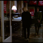 "Paul Blondell and JoJo carry equipment through the Times Square Renaissance offices - frame capture from ""Times Square"" (1980)"