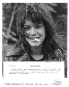 "Publicity still of Robin Johnson from the ""Times Square"" US Press Materials folder. Text: TS-57-26 ""TIMES SQUARE"" Robin Johnson, 16-year-old Brooklyn miss, makes her feature film singing and acting debut as Nicky Marotta, an uninhibited product of the streets who sets New York City on edge as a wild runaway from authority in ""Times Square."" Publicity Department, AFD, 12711 Ventura Blvd., Studio City, CA. 91604 AFD ©1980 Associated Film Distribution"