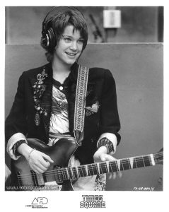 "Robin Johnson as Nicky Marotta, holding her Rickenbacker guitar in the WJAD studio.  Publicity still from the ""Times Square"" US Press Materials folder.  Text:  (on image) TS-69-34A/4  (on border)TIMES SQUARE AFD ©1980 Associated Film Distribution"