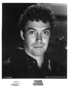 "Publicity still of Tim Curry from the ""Times Square"" US Press Materials folder. Text: (on image) TS-79-28/8 (on border) TIMES SQUARE AFD ©1980 Associated Film Distribution"