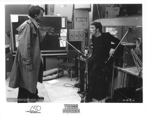 "Publicity still of Peter Coffield and Tim Curry in the WJAD studio from the ""Times Square"" US Press Materials folder. Text: (on image) TS-78-2/16 (on border) TIMES SQUARE AFD ©1980 Associated Film Distribution"