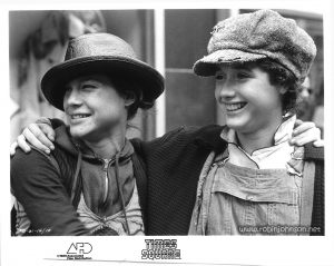 "Publicity still of Robin Johnson and Trini Alvarado on the northwest corner of 50th Street and 8th Avenue, from the ""Times Square"" US Press Materials folder.   Text:  TS-61-14/10 TIMES SQUARE AFD ©1980 Associated Film Distribution"
