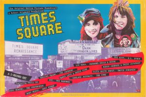 """Times Square"" soundtrack promotional poster, 32"" (H) x 48"" (W), 1980 Text: The Original Motion Picture Soundtrack A Robert Stigwood Production TIMES SQUARE ™ A 2-RECORD SET Featuring Music Of: SUZI QUATRO, THE PRETENDERS ROXY MUSIC, GARY NUMAN TALKING HEADS, JOE JACKSON MARCY LEVY & ROBIN GIBB XTC, THE RAMONES GARLAND JEFFREYS, THE CURE LOU REED, DESMOND CHILD & ROUGE THE RUTS, D.L. BYRON ROBIN JOHNSON & TRINI ALVARADO PATTI SMITH GROUP, DAVID JOHANSEN RSO Records, Inc. ® © 1980 RSO Records, Inc. OP-200"