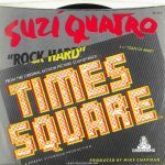"Back of the picture sleeve for the Suzi Quatro ""Rock Hard"" single included in the ""Rock Hard"" promo pack. Text: DL-104 SUZI QUATRO ""ROCK HARD"" FROM THE ORIGINAL MOTION PICTURE SOUNDTRACK TIMES SQUARE ™ A ROBERT STIGWOOD PRODUCTION B/W ""STATE OF MIND"" DREAMLAND PRODUCED BY MIKE CHAPMAN [This digital surrogate was ceated by Sean Rockoff for robinjohnson.net.)"