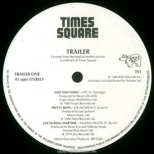 "Side 1 of the UK promotional sampler record TS-1, ""Times Square"" Trailer. Text: TIMES SQUARE TRAILER Excerpts from the original motion picture soundtrack of Times Square TRAILER ONE 45 rpm STEREO TS1 © 1980 RSO Records Inc. Marketed and distributed by Polydor Ltd. TAKE THIS TOWN - XTC (A. Partridge) Produced by Steve Lillywhite Virgin Music (Publishers) Ltd. ℗ 1980 Virgin Records Ltd. PRETTY BOYS-JOE JACKSON (J. Jackson) Produced by Joe Jackson Albion Music Ltd. ℗ 1980 A&M Records Ltd. LIFE DURING WARTIME - TALKING HEADS (D. Byrne) Produced by Brian Eno and Talking Heads Warner Bros Music Ltd. ℗ 1979 Sire Records Ltd. Album Executive Producer: Bill Oaks ALL RIGHTS OF THE MANUFACTURER AND OF THE OWNER OF THE RECORDED WORK RESERVED ● UNAUTHORISED PUBLIC PERFORMANCE BROADCASTING AND COPYING OF THIS RECORD PROHIBITED. [This digital surrogate created by Sean Rockoff for robinjohnson.net.]"