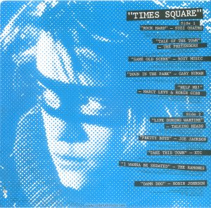 "A blue pixellated image of Robin Johnson. Text: ""TIMES SQUARE"" Side 1 ""ROCK HARD"" - SUZI QUATRO. PRODUCED BY MIKE CHAPMAN (by Mike Chapman and Nicky Chinn; Chinnichap Publishing Inc. Admin. in the U.S.A. & Canada bv Careers Music Inc.) (BMI) (COURTESY OF DREAMLAND RECORDS, INC.) ℗ 1980 DREAMLAND RECORDS, INC. ""TALK OF THE TOWN"" - THE PRETENDERS PRODUCED BY CHRIS THOMAS (by Chrissie Hynde; Al Gallico Music Corp. (BMI) (COURTESY OF SIRE RECORDS, INC. /REAL RECORDS) ℗ 1980 REAL RECORDS ""SAME OLD SCENE"" - ROXY MUSIC PRODUCED BY ROXY MUSIC AND RHETT DAVIES (by Bryan Ferry; E.G. Music, Inc.) (BMI) (COURTESY OF E.G. RECORDS, LTD. /ATLANTIC RECORDING CORP. / POLYDOR INTERNATIONAL) ℗ 1980 ATLANTIC RECORDING CORPORATION ""DOWN IN THE PARK"" - GARY NUMAN PRODUCED BY GARY NUMAN (by Gary Numan; Geoff & Eddie Music, Inc. and Blackwood Music Inc.) (BMI) (COURTESY OF WEA RECORDS, LTD. /BEGGARS BANQUET LIMITED) ℗1979 A BEGGARS BANQUET RECORDING ""HELP ME!"" - MARCY LEVY &ROBIN GIBB PRODUCED BY ROBIN GIBB AND BLUE WEAVER (by Robin Gibb and Blue Weaver; Stigwood Music, Inc. (Unichappell Music, Admin.) (BMI) ℗ 1980 YAM, INC. Side 2 ""LIFE DURING WARTIME"" - TALKING HEADS PRODUCED BY BRIAN ENO AND TALKING HEADS (by David Byrne ; Index Music /Bleu Disque Music Co. Inc.) (ASCAP) (COURTESY OF SIRE RECORDS, INC. /REAL RECORDS) ℗ 1979 SIRE RECORDS COMPANY ""PRETTY BOYS"" - JOE JACKSON PRODUCED BY JOE JACKSON (by Joe Jackson; Albion Music, Ltd.) (Admin. by Almo Music Corp. in the U.S. & Canada( (ASCAP) (COURTESY OF A&M RECORDS, INC.) ℗ 1980 Multiplier N.V. ""TAKE THIS TOWN"" - XTC PRODUCED BY STEVE LILLYWHITE (by Andy Partridge; NymphMusic ) (Unichappell Music, Admin.) (BMI) (COURTESY OF VIRGIN RECORDS, LTD.) ℗ 1980 VIRGIN RECORDS LTD. ""I WANNA BE SEDATED"" - THE RAMONES PRODUCED BY T. ERDELYI AND ED STASIUM (by The Ramones; Bleu Dique Music Co. Inc. /Taco Tunes, Inc.) (ASCAP) (COURTESY OF SIRE RECORDS, INC. /REAL RECORDS) ℗ 1978 SIRE RECORDS, INC. ""DAMN DOG"" - ROBIN JOHNSON PRODUCED BY BILL OAKES (by Billy Mernit and Jacob Brackman; Stigwood Music, Inc. (Unichappell Music, Admin.) (BMI) Engineer: Thom Panunzio ℗ 1980 Multiplier N.V. RS-2-4203 © 1980 Butterfly Valley NV"