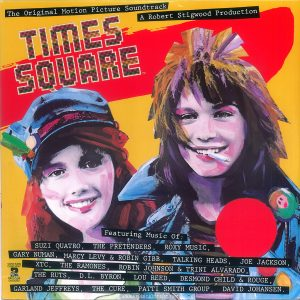 "The front cover of the Canadian edition of the ""Times Square"" soundtrack album features a blank red circle in place of the image of Tim Curry. Text: The Original Motion Picture Soundtrack A Robert Stigwood Production TIMES SQUARE Featuring Music Of: SUZI QUATRQ, THE PRETENDERS, R0XY MUSIC, GARY NUMAN, MARCY LEVY & ROBIN GIBB, TALKING HEADS, JOE JACKSON, XTC, THE RAMONES, ROBIN JOHNSON & TRINI ALVARADO, THE RUTS, D.L. BYRON. LOU REED, DESMOND CHILD &, ROUGE, GARLAND JEFFREYS, THE CURE, PATTT SMITH GROUP, DAVID JOHANSEN . CONTAINS CONTIENT 2 RECORDS DISQUES (This digital surrogate created by Sean Rockoff for robinjohnson.net.)"
