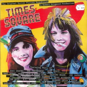 "The front of the UK edition of the ""Times Square"" soundtrack album is missing the image of Tim Curry. Text: The Original Motion Picture Soundtrack A Robert Stigwood Production TIMES SQUARE Featuring Music Of: SUZI QUATRQ, THE PRETENDERS, R0XY MUSIC, GARY NUMAN, MARCY LEVY & ROBIN GIBB, TALKING HEADS, JOE JACKSON, XTC, THE RAMONES, ROBIN JOHNSON & TRINI ALVARADO, THE RUTS, D.L. BYRON. LOU REED, DESMOND CHILD &, ROUGE, GARLAND JEFFREYS, THE CURE , PATTT SMITH GROUP, DAVID JOHANSEN ."