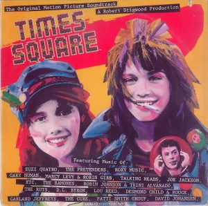 "The front cover of the US edition of the ""Times Square"" Original Motion Picture Soundtrack Text: The Original Motion Picture Soundtrack A Robert Stigwood Production TIMES SQUARE Featuring Music Of: SUZI QUATRQ, THE PRETENDERS, R0XY MUSIC, GARY NUMAN, MARCY LEVY & ROBIN GIBB, TALKING HEADS, JOE JACKSON, XTC, THE RAMONES, ROBIN JOHNSON & TRINI ALVARADO, THE RUTS, D.L. BYRON, LOU REED, DESMOND CHILD &, ROUGE, GARLAND JEFFREYS, THE CURE, PATTI SMITH GROUP, DAVID JOHANSEN."